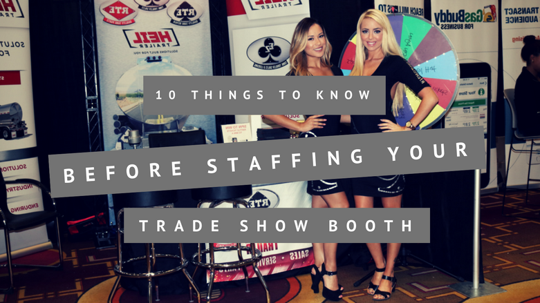 two trade show staffers at a booth